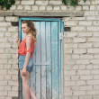 Portrait of beauty girl standing near brick wall — Stock Photo