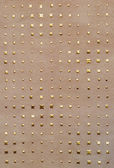 Abstract beige background with metallic stars — Stock Photo