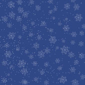 Christmas blue background with falling snowflakes — Stock Vector