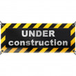Under construction sign on chain — Stock Photo