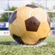 Wooden football on penalty spot — Stock Photo