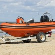 Stock Photo: Trailer with boat for emergency services on beach