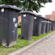 Grey garbage containers in a row — Stock Photo