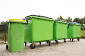 Green garbage containers in a row — Stock Photo