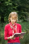 Woman reading a book in nature — Foto de Stock