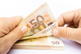 Two hands counting euro notes — Stock Photo