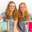 Schoolgirls carrying textbooks — Stock Photo