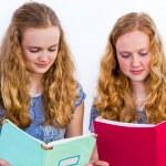 Two schoolgirls reading books — Stock Photo #48134723