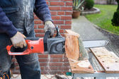 Chain saw cutting wood — Stock Photo