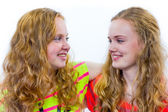 Two teenage girls embracing each other — Stock Photo