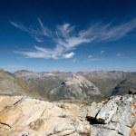 Alpine valley seen from a rocky ridge. Hiking in Swiss Alps. Switzerland. — Stock Photo #31553333