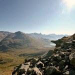 Alpine valley seen from a rocky ridge. Hiking in Swiss Alps. Switzerland. — Stock Photo #31553395