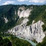 Rhine river gorge in Swiss Alps, Switzerland. River winding under high cliffs. — Stock Photo #31553529