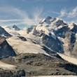 Piz Bernina and glaciers in the valley seen from Diavolezza and Munt Pars. Alps in Switzerland. — Stock Photo #31553569