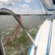 Splashes of water seen from speeding yacht under sails — Stock Photo #32475049
