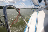 Splashes of water seen from speeding yacht under sails — Stock Photo