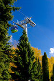 Aerial tram, cable car in park in autumn — Stock Photo