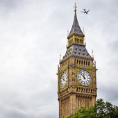 Big Ben with airplane — Stock Photo
