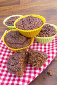 Home made chocolate muffins on a napkin — Stock Photo