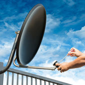 Craftsman Repair Satellite Dish — Stock Photo