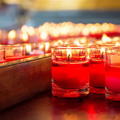 Red candle in glass — Stock Photo