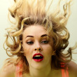 Woman with flying hair — Stock Photo