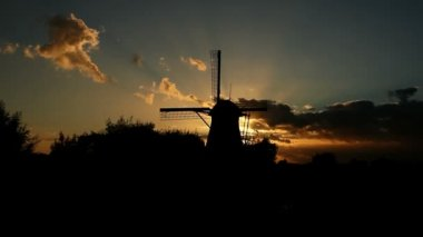 Silhouette of a Windmill at Sunset and a Swarm of Mosquitos — Stock Video
