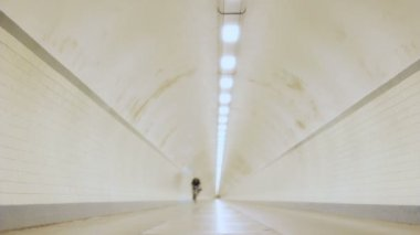 Cyclists Cycling by in Tunnel — Stock Video
