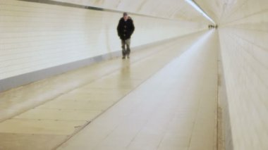 Lonely Man Walking head down in a Tunnel in Slow Motion — Stock Video