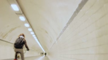 Pedestrians and Cyclist in Round Subway Tunnel — Stock Video
