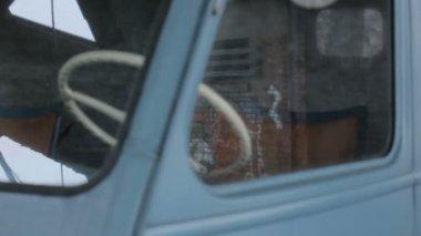 Reflection of Graffiti in Van Window — Stock Video