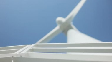 Turbine Windmill Out of Focus behind Railing of Metal Staircase under Blue Sky — Stock Video