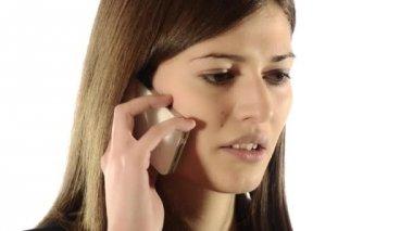Brunette girl quarreling on the telephone — Stock Video