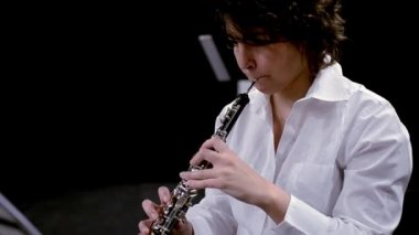 Young musician woman playing oboe — Video Stock