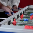 Stock Video: Playing foosball