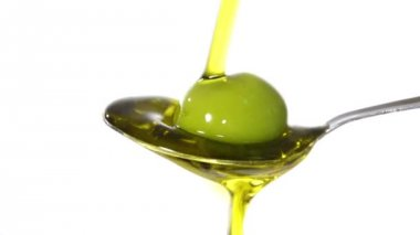 Olive oil on a spoon — Stock Video