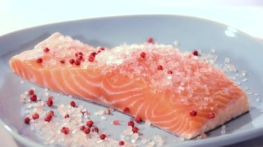 Salmon fillet with himalayan salt and pepper — Stock Video