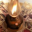 Old tarot cards rotating and oil lamp — Stock Video