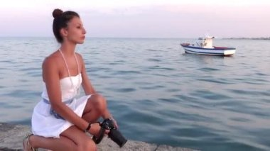 Nice girl taking a photograph with her camera — Stock Video