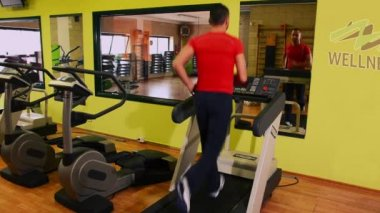 Treadmill. Man at the gym. — Stock Video