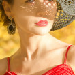 Стоковое фото: Portrait of female caucasian, with shadow pattern from hat on face