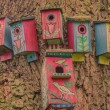 Painted birdhouses on a tree — Stock Photo