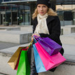Young woman with gift bags — Stock Photo