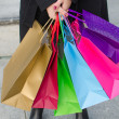 Parts of body of young woman with shopping bags — Stock Photo