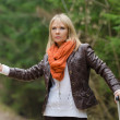 Pretty girl hitchhiking — Stock Photo #35691497