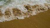 Wave in the sandy Mediterranean beach — Stock Photo