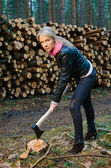 Young pretty woman with huge axe — Stock Photo