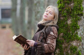 Young woman with a Bible — Stock Photo