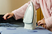 Woman hands in ironing process — Stok fotoğraf