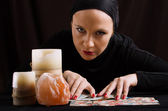 Young woman with divination cards — Stock Photo